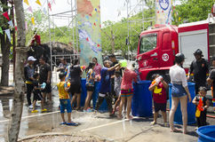 Thai people and foreigner travelers playing and splashing water with elephants and people in Songkran Festival. At Ayutthaya city on April 14, 2017 in Ayutthaya Stock Images