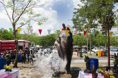 Thai people and foreigner travelers playing and splashing water with elephants and people in Songkran Festival at Ayutthaya. City on April 14, 2017 in Ayutthaya stock photography