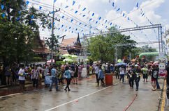Thai people and foreigner travelers playing and splashing water with elephants and people in Songkran Festival at Ayutthaya Royalty Free Stock Photography