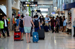 Thai people and foreiner traveller wait and walk at Suvarnabhumi Royalty Free Stock Photos