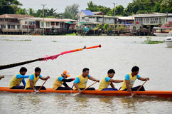 Thai people join match and competition in thailand traditional long boat racing festiva Royalty Free Stock Image