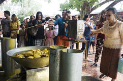Thai people join melting cast candle offer to temple in traditio Royalty Free Stock Image