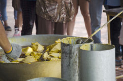 Thai people join melting cast candle offer to temple in traditio Stock Photos