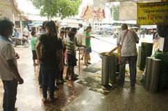 Thai people join melting cast candle offer to temple in traditio Royalty Free Stock Photography