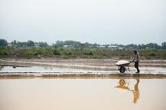 Thai people keeping salt from Salt farming Royalty Free Stock Photo
