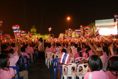 Thai people at the kings birthday, Thailand. BANGKOK, THAILAND - DECEMBER 5: Thai people sit outside the kings palace watching the entertainment performed for Royalty Free Stock Photography