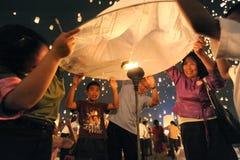 Launching sky lanterns Stock Images
