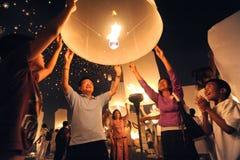 Launching sky lanterns Stock Photography