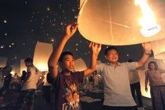 Launching sky lanterns Stock Photos