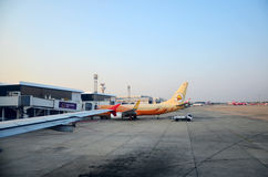 Thai people loading baggage to store room of plane for flight at Royalty Free Stock Image
