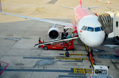 Thai people loading baggage to store room of plane Royalty Free Stock Images