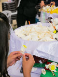 Thai People making Funeral Flower for late King cremation. Royalty Free Stock Photos