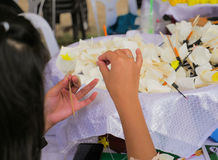 Thai People making Funeral Flower for late King cremation. Stock Images