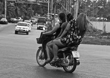 Thai people on a motorbike royalty free stock photo