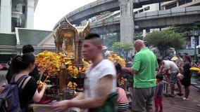 Thai people near mini buddhist temple in Bangkok, Thailand stock footage
