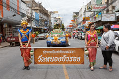 Thai people participate parade in grand of opening the traditional candle procession festival of Buddha Stock Photos