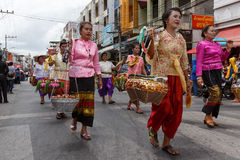 Thai people participate parade in grand of opening the traditional candle procession festival of Buddha Royalty Free Stock Photography