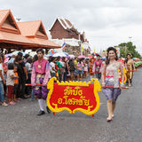 Thai people participate parade in grand of opening the traditional candle procession festival of Buddha Royalty Free Stock Images