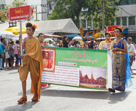 Thai people participate parade in grand of opening the traditional candle procession festival of Buddha Royalty Free Stock Image