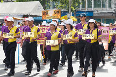 Thai people participate parade in grand of opening the traditional candle procession festival of Buddha Stock Image