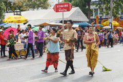 Thai people participate parade in grand of opening the traditional candle procession festival of Buddha Stock Photography