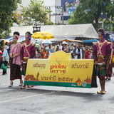 Thai people participate parade in grand of opening the traditional candle procession festival of Buddha Royalty Free Stock Photos