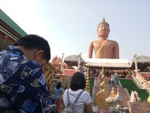 Thai people praying to the statue of Buddha royalty free stock photography