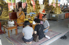 Thai people praying at wat trimit temple Royalty Free Stock Photography