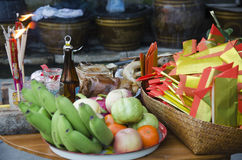 Thai people prepare sacrificial offering food on table for pray. God and memorial to ancestor in Chinese new year day at home on January 28, 2017 in Bangkok Royalty Free Stock Photography