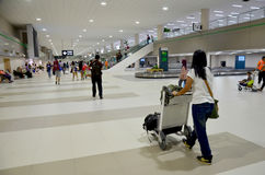 Thai people push trolley carry bag at Don Mueang International A Royalty Free Stock Photography
