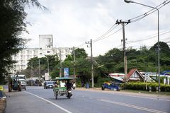 Thai people riding and driving on the road at Ban Phe village in Rayong, Thailand royalty free stock image