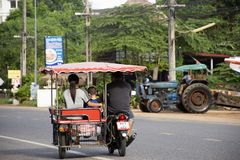 Thai people riding and driving on the road at Ban Phe village in Rayong, Thailand royalty free stock images
