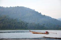 Thai people sail long tail boat in lake at Khao Sok National Par Royalty Free Stock Photo