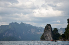 Thai people sail long tail boat serviced for send and receive in. Thai people sail long tail boat serviced for sending and receive people travel in Cheow Lan Royalty Free Stock Images