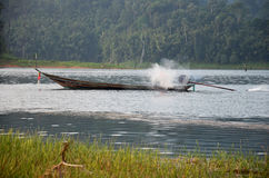 Thai people sail long tail boat serviced for send and receive in. Thai people sail long tail boat serviced for sending and receive people travel in Cheow Lan Royalty Free Stock Photography