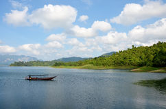 Thai people sail long tail boat serviced for sending and receive. People travel in Cheow Lan Lake at Ratchaprapa or Rajjaprabha Dam Reservoir in Khao Sok Stock Photos