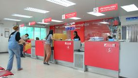 Thai people sending parcel post and employee service customer by fast and friendly at post office stock video footage