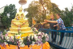 Thai people sprinkling scented water on the Buddha Image in Song. BANGKOK,THAILAND- APRIL 12,2015 : Unidentified Thai people sprinkling scented water on the Royalty Free Stock Image