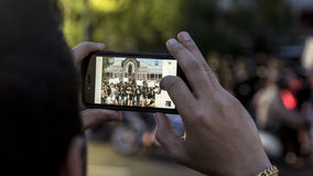 Thai people take picture by mobile phone in tribute to King Rama IX at the Temple of the Emerald Buddha Royalty Free Stock Image