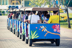 Thai people and tourists are riding the street tram viewing around the Rama 9 Royal garden Royalty Free Stock Images