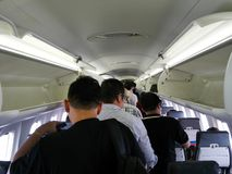 Thai people and traveler passengers walking out of plane stock photography