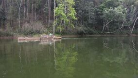 Thai people and travelers foreign travel rowing bamboo rafts on Pang Ung lake