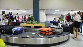 Thai people and traveller wait receive luggage on carousel conveyor stock footage