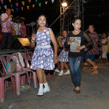 Thai people unidentified folk dance and traditional costumes on night market walk street. Stock Photo