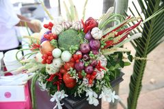 Thai people use flowers and fruits to weave flower baskets. Thai people use onions, tomatoes, peppers, tomatoes, garlic and other fruits and some flowers woven stock photo