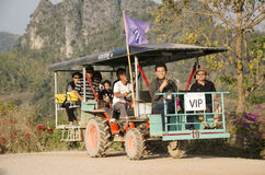 Thai people use tractor for service travelers tour Phu Pa Po mountain or Fuji City Loei. On lateritic soil road go to at Phu Luang on February 22, 2017 in Loei Stock Images