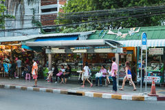 Thai people wait bus at bus stop in Bangkok Stock Photo