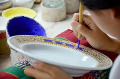 Thai people woking process paint Ceramic Benjarong is traditiona Royalty Free Stock Images