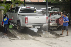 Thai people workers cleaning and washing car at local carwash st Royalty Free Stock Image