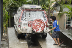 Thai people workers cleaning and washing car at local carwash st Royalty Free Stock Photos